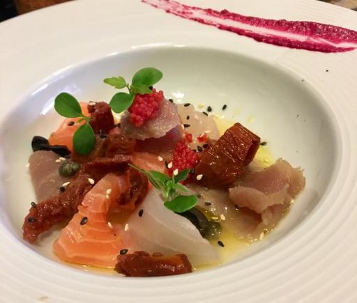 Carpaccio misto marinato a coltello, di tonno branzino e salmone norvegese